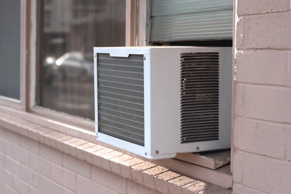 an air conditioning unit in a window, viewed from exterior